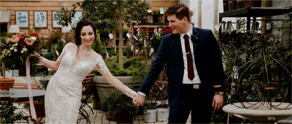 Wedding couple dancing in the greenhouse at Long Hollow Gardens  in Gallatin, TN